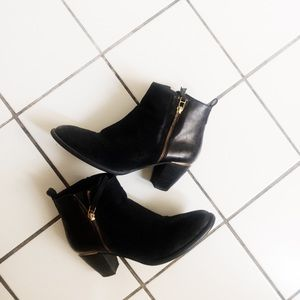 black booties w gold zip detail